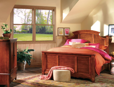 Double Hung twin woodgrain no locks vinyl replacement windows in a bedroom