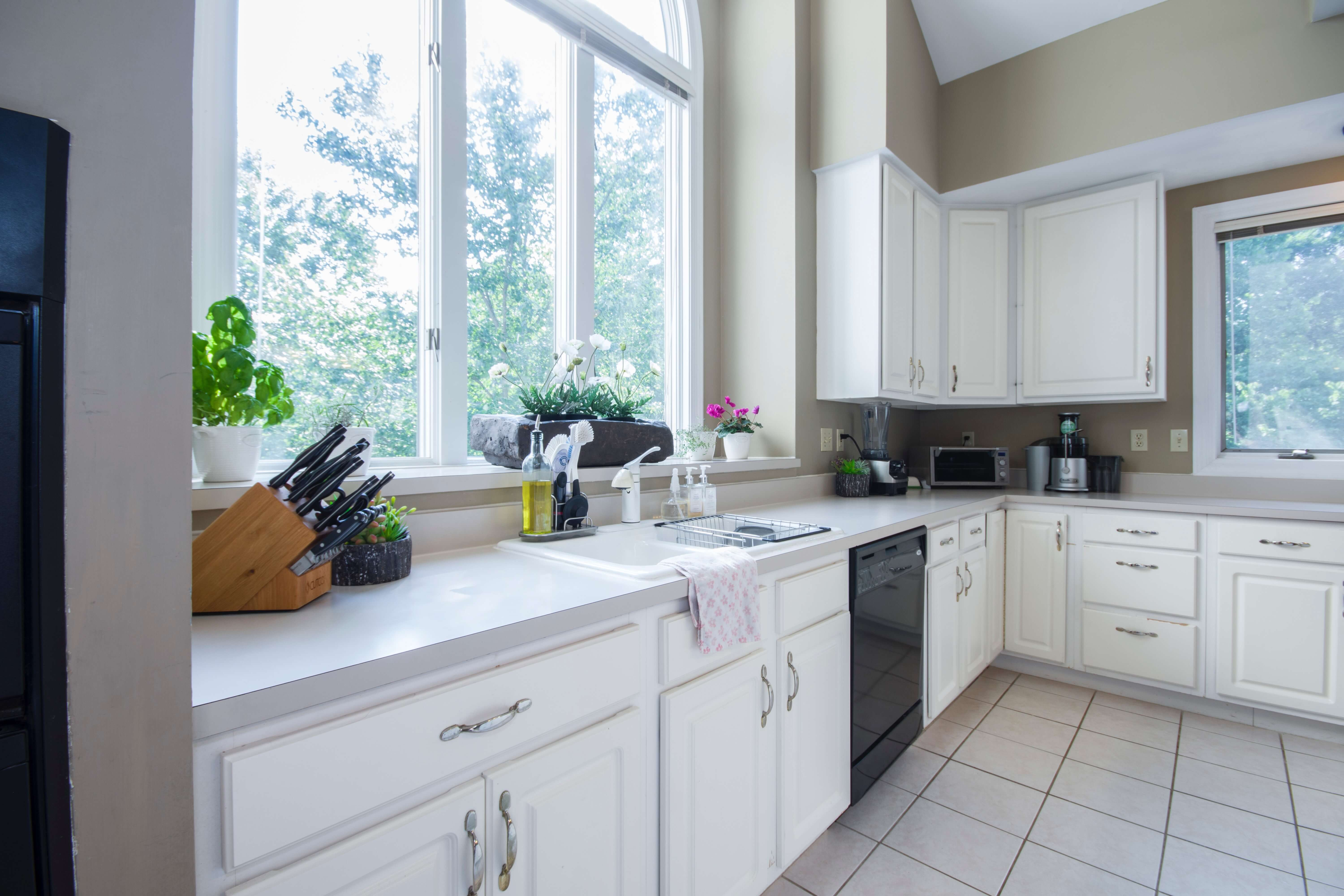 Restorations Windows with custom geometric designs let in ample light to any kitchen